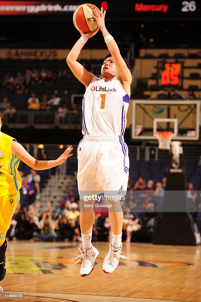 Yuko Oga of the Phoenix Mercury shoots against the JX Sunflowers on May 24 2011 at US Airways Center in Phoenix Arizona NOTE TO USER User expressly...