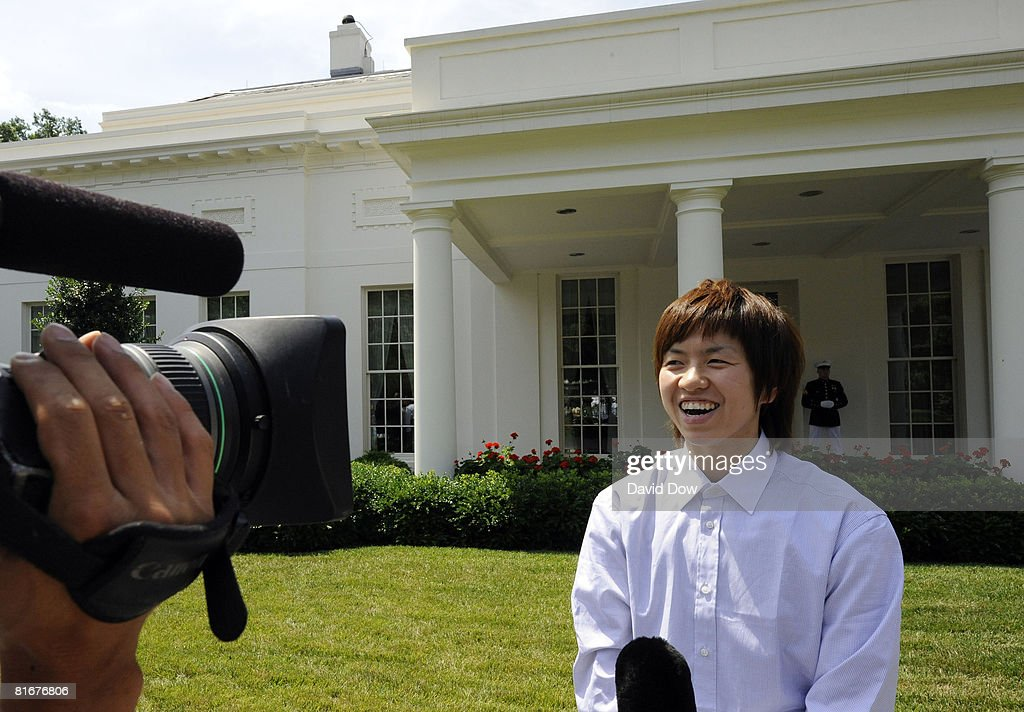 Yuko Oga of the Phoenix Mercury speaks to the press outside the Oval Office during her visit with her teammates the 2007 WNBA Champions at the White...