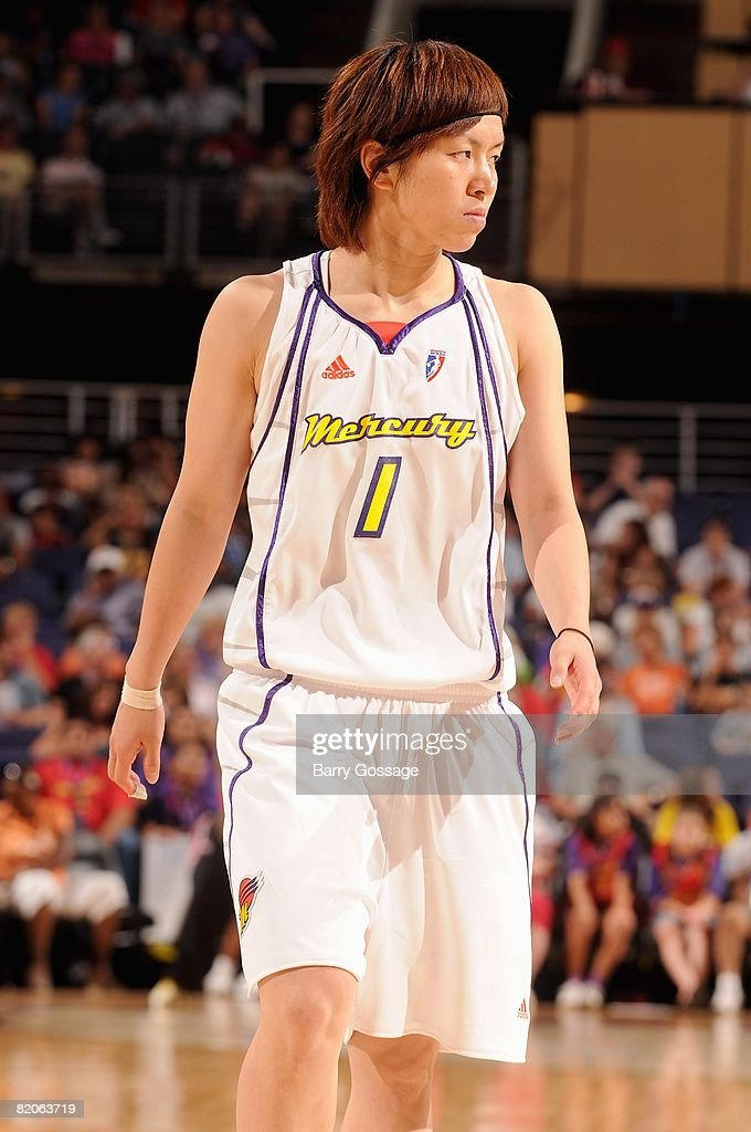Yuko Oga of the Phoenix Mercury walks upcourt during the WNBA game against the New York Liberty on July 5 2008 at US Airways Center in Phoenix...