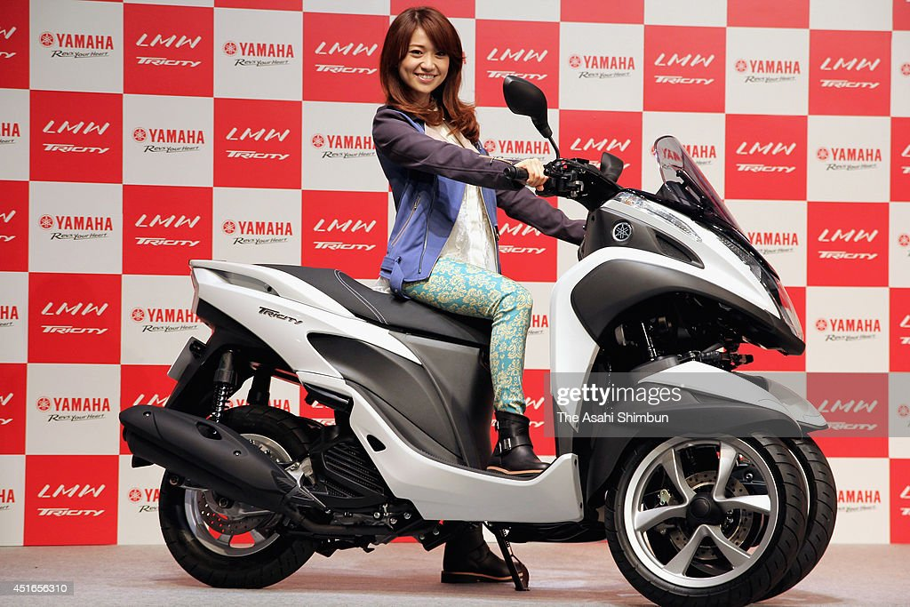 <a gi-track='captionPersonalityLinkClicked' href=/galleries/search?phrase=Yuko+Oshima&family=editorial&specificpeople=5573990 ng-click='$event.stopPropagation()'>Yuko Oshima</a> promotes the Yamaha Motor Co's new 'Tricity' at UDX on July 1, 2014 in Tokyo, Japan.