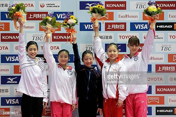 Yuko Shintake Koko Tsurumi Asuka Teramoto Yu Minobe and Rie Tanaka pose on the podium as they are qualified for the Japan Women's gymnastics team for...