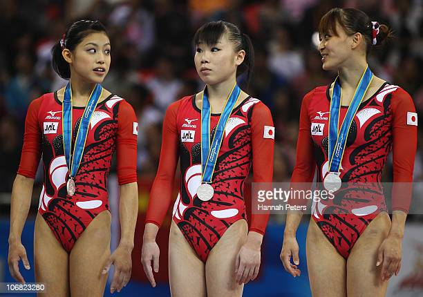 Yuko Shintake Momoko Ozawa and Rie Tanaka of Japan celebrate winning silver after competing in the Women's Team Final at the Asian Games Town...