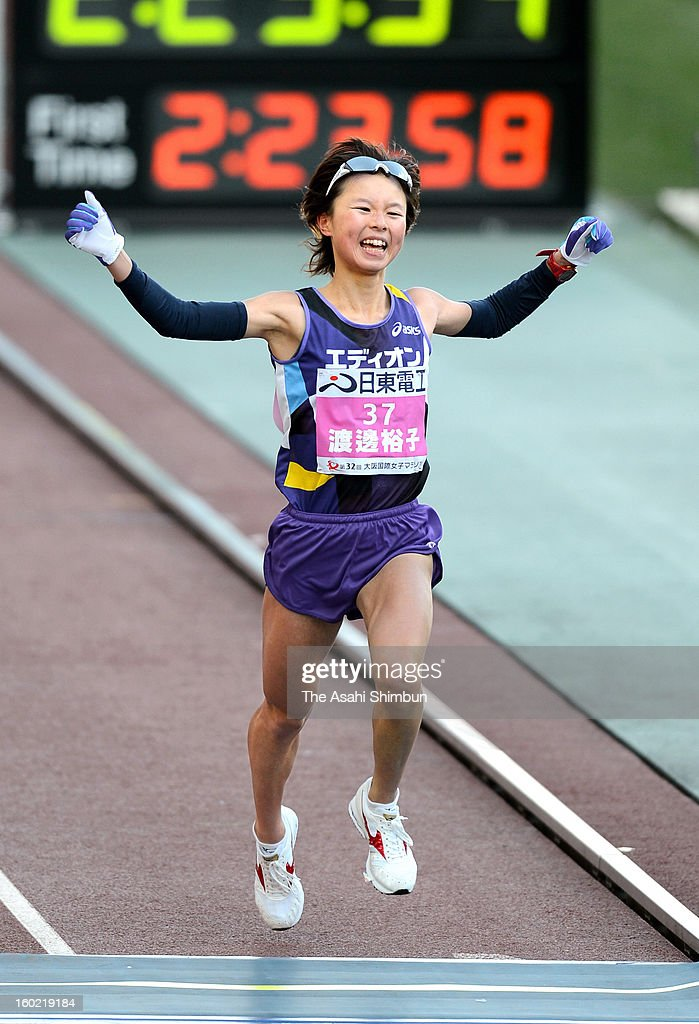 Yuko Watanabe of Japan crosses the finishing line as third during the 32nd Osaka International Women's Marathon at Nagai Stadium on January 27, 2013 in Osaka, Japan.