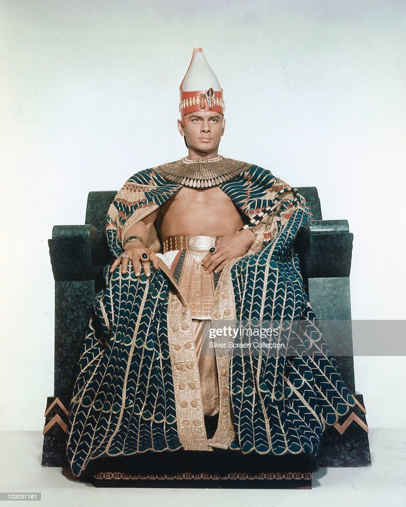<a gi-track='captionPersonalityLinkClicked' href=/galleries/search?phrase=Yul+Brynner&family=editorial&specificpeople=204712 ng-click='$event.stopPropagation()'>Yul Brynner</a> (1920-1985), Russian-born US actor, in costume sitting on a throne in a publicity portrait issued for the film, 'The Ten Commandments', 1956. The biblical epic, directed by Cecil B. DeMille (1881-1959), starred Brynner as 'Pharaoh Rameses II'.