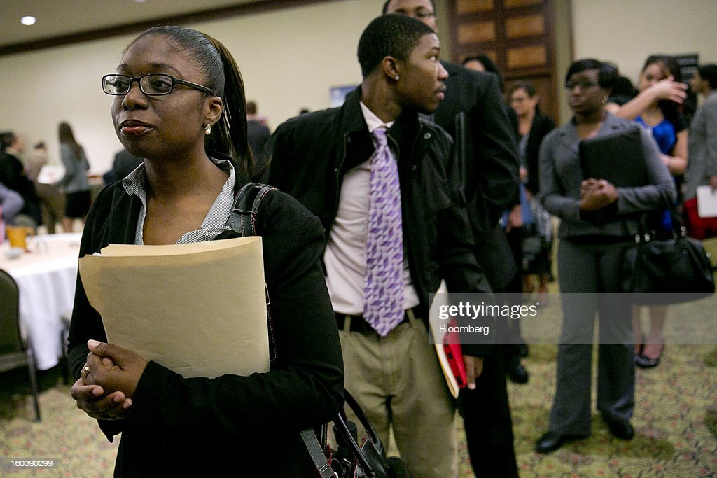 Yulanda Tappin, left, waits in a job recruitment line at a National Career Fairs job fair in Arlington, Virginia, U.S., on Wednesday, Jan. 30, 2013. The U.S. Labor Department is scheduled to release initial jobless claims data on Jan. 31. Photographer: Andrew Harrer/Bloomberg via Getty Images