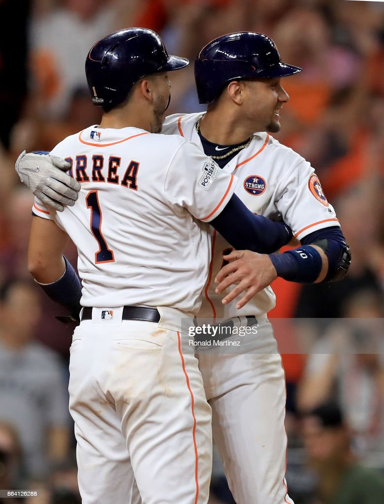 Yuli Gurriel #10 and Carlos Correa #1 of the Houston Astros celebrate after they scored off of a double hit by Alex Bregman #2 against David Robertson #30 of the New York Yankees during the eighth inning in Game Six of the American League Championship Series at Minute Maid Park on October 20, 2017 in Houston, Texas.