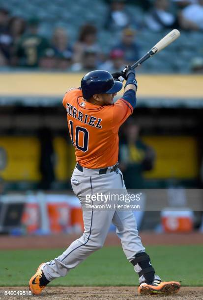 Yuli Gurriel of the Houston Astros bats against the Oakland Athletics in the top of the six inning at Oakland Alameda Coliseum on September 9 2017 in...