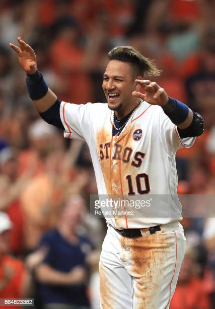 Yuli Gurriel of the Houston Astros celebrates after scoring off of a double hit by Brian McCann against Tommy Kahnle of the New York Yankees during...