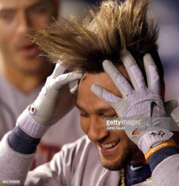 Yuli Gurriel of the Houston Astros celebrates in the dugout after hitting a 3run home run during the 9th inning of the game against the Kansas City...