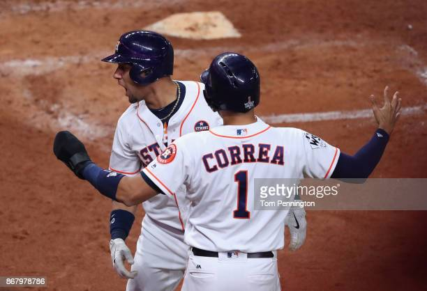 Yuli Gurriel of the Houston Astros celebrates with Carlos Correa after hitting a three run home run during the fourth inning against the Los Angeles...