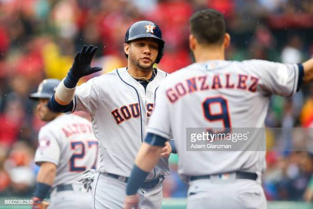 Yuli Gurriel of the Houston Astros celebrates with Marwin Gonzalez after scoring in the second inning of Game 4 of the American League Division...