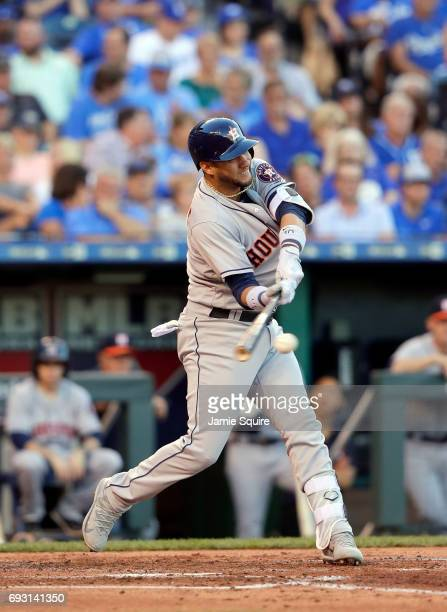 Yuli Gurriel of the Houston Astros connects with the bases loaded to drive in two runs during the 3rd inning of the game against the Kansas City...