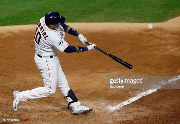 Yuli Gurriel of the Houston Astros hits a double during the seventh inning against the Los Angeles Dodgers in game three of the 2017 World Series at...
