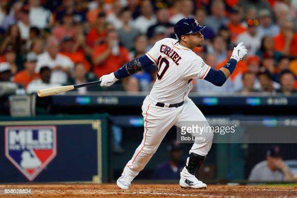 Yuli Gurriel of the Houston Astros hits a single in the sixth inning against the Boston Red Sox during game one of the American League Division...