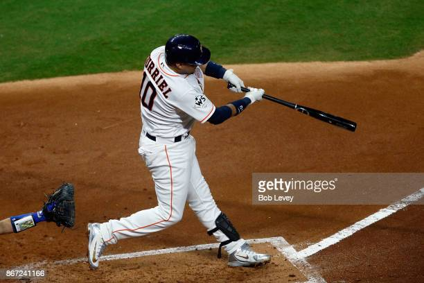 Yuli Gurriel of the Houston Astros hits a solo home run during the second inning against the Los Angeles Dodgers in game three of the 2017 World...