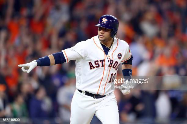 Yuli Gurriel of the Houston Astros hits a solo home run in the bottom of the second inning of Game 3 of the 2017 World Series against the Los Angeles...