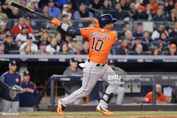 Yuli Gurriel of the Houston Astros hits a three run double during Game 4 of the American League Championship Series against the New York Yankees at...