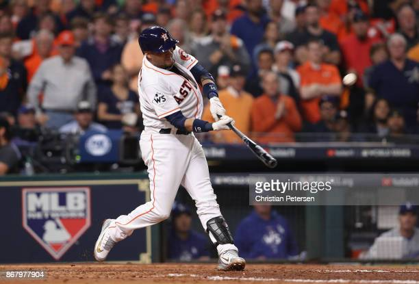 Yuli Gurriel of the Houston Astros hits a three run home run during the fourth inning against the Los Angeles Dodgers in game five of the 2017 World...