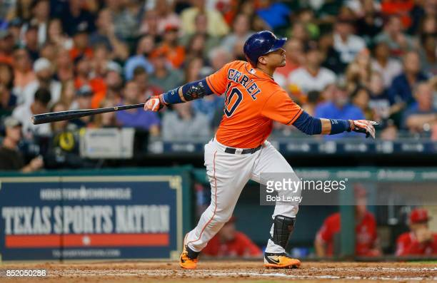 Yuli Gurriel of the Houston Astros hits a threerun home run in the seventh inning against the Los Angeles Angels of Anaheim at Minute Maid Park on...