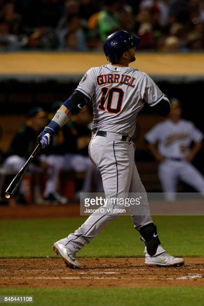 Yuli Gurriel of the Houston Astros hits a two run home run against the Oakland Athletics during the third inning at the Oakland Coliseum on September...