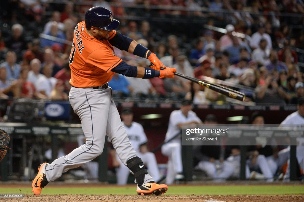 Yuli Gurriel #10 of the Houston Astros hits an RBI triple in the fourth inning against the Arizona Diamondbacks at Chase Field on August 15, 2017 in Phoenix, Arizona.