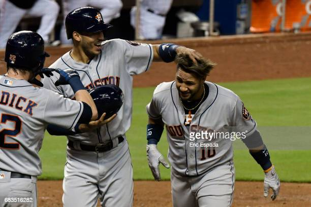 Yuli Gurriel of the Houston Astros is congratulated by Carlos Correa after hitting a grand slam in the sixth inningagainst the Miami Marlins at...