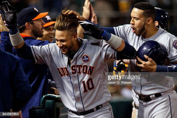 Yuli Gurriel of the Houston Astros is congratulated by Carlos Correa after hitting a two run home run against the Oakland Athletics during the third...