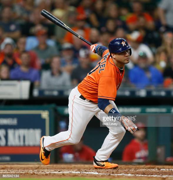 Yuli Gurriel of the Houston Astros lines out to right field in the fifth inning against the Los Angeles Angels of Anaheim at Minute Maid Park on...
