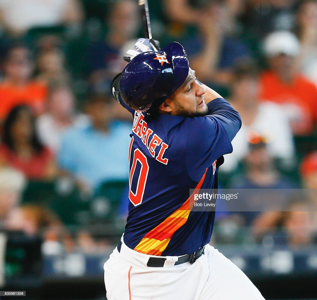 Yuli Gurriel #10 of the Houston Astros loses his helmet as he swings through a pitch in the ninth inning against the Oakland Athletics at Minute Maid Park on August 20, 2017 in Houston, Texas.