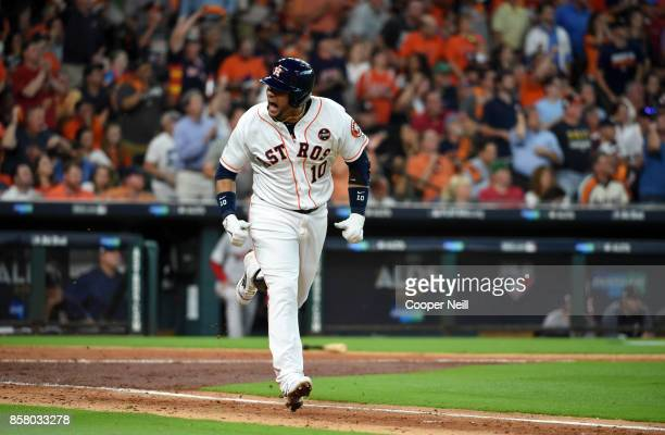Yuli Gurriel of the Houston Astros reacts after getting a hit during Game 1 of the American League Division Series against the Boston Red Sox at...