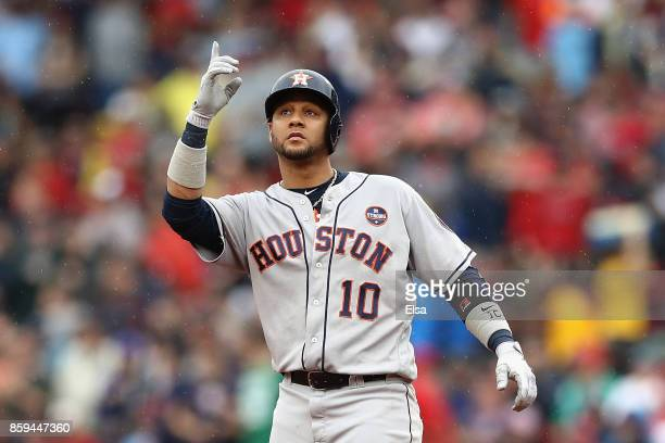 Yuli Gurriel of the Houston Astros reacts after hitting a double in the third inning against the Boston Red Sox during game four of the American...