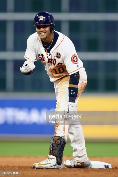 Yuli Gurriel of the Houston Astros reacts after hitting a double during the seventh inning against the Los Angeles Dodgers in game three of the 2017...