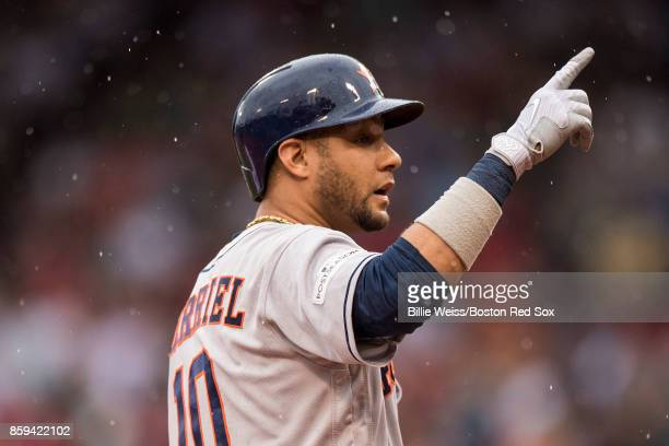 Yuli Gurriel of the Houston Astros reacts after hitting a triple during the second inning of game four of the American League Division Series against...