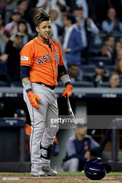 Yuli Gurriel of the Houston Astros reacts after striking out during the fourth inning against the New York Yankees in Game Five of the American...