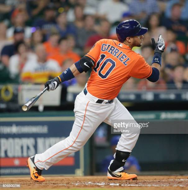 Yuli Gurriel of the Houston Astros singles in a run in the third inning against the Toronto Blue Jays at Minute Maid Park on August 4 2017 in Houston...