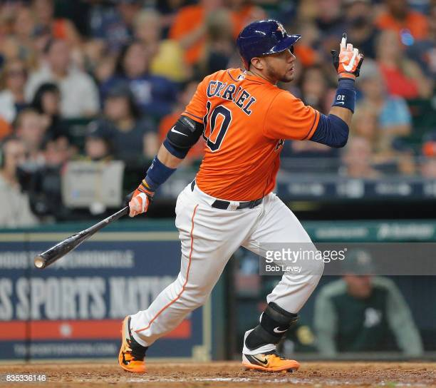 Yuli Gurriel of the Houston Astros singles in the sixth inning against the Oakland Athletics at Minute Maid Park on August 18 2017 in Houston Texas