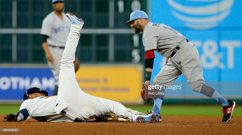 Yuli Gurriel #10 of the Houston Astros slides safely in to second base as Dustin Pedroia #15 of the Boston Red Sox applies the tag in the sixth inning at Minute Maid Park on June 17, 2017 in Houston, Texas.