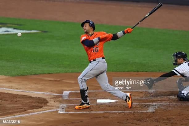 Yuli Gurriel of the Houston Astros swings at a pitch against the New York Yankees during the second inning in Game Four of the American League...