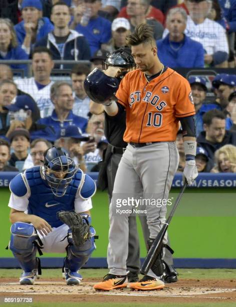 Yuli Gurriel of the Houston Astros tips his helmet to Los Angeles Dodgers pitcher Yu Darvish in the first inning in Game 7 of the World Series at...