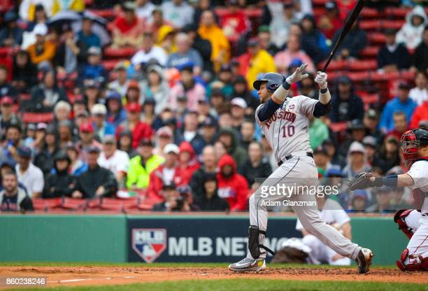 Yuli Gurriel of the Houston Astros triples in the second inning of Game 4 of the American League Division Series against the Boston Red Sox at Fenway...