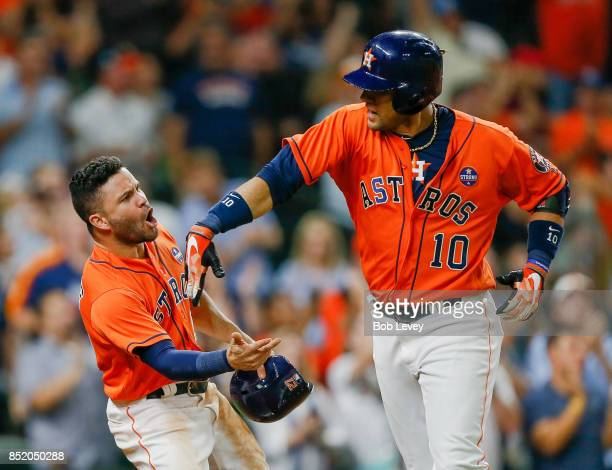 Yuli Gurriel of the Houston Astrosis congratulated by Jose Altuve after hitting a threerun home run in the seventh inning against the Los Angeles...