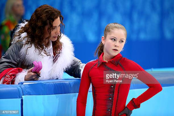 Yulia Lipnitskaya of Russia talks with her coach Eteri Tutberidze before competing in the Figure Skating Ladies' Free Skating on day 13 of the Sochi...