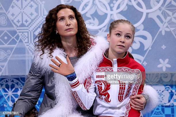 Yulia Lipnitskaya of Russia waits for her score with her coach Eteri Tutberidze in the Figure Skating Ladies' Short Program on day 12 of the Sochi...