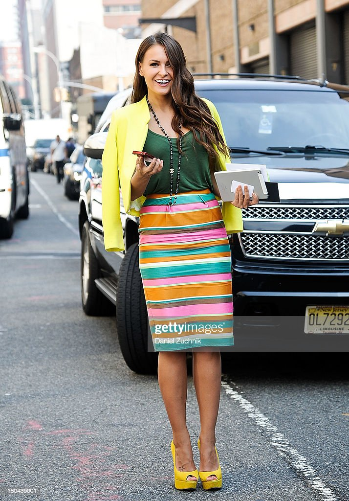 Yulia Olyazima is seen outside the Ralph Lauren show wearing a Top Shop blazer, Asos skirt, Steve Madden shoes, Zara bag and Chanel accessories on September 12, 2013 in New York City.