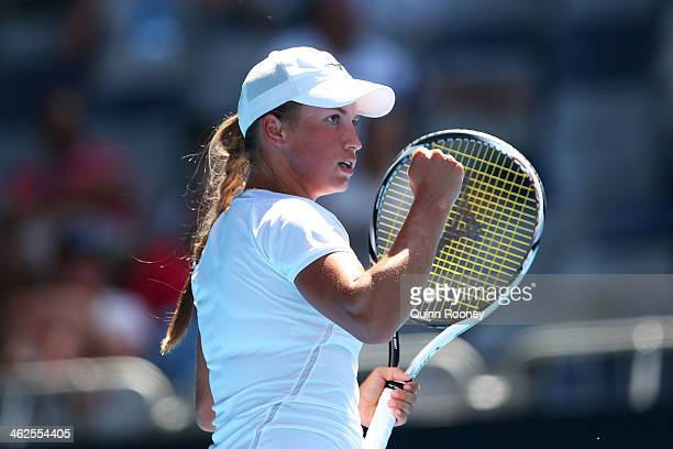 Yulia Putintseva of Kazakhstan celebrates a point in her first round match against Agnieszka Radwanska of Poland during day two of the 2014...