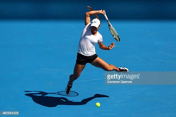 Yulia Putintseva of Kazakhstan plays a backhand in her first round match against Agnieszka Radwanska of Poland during day two of the 2014 Australian...