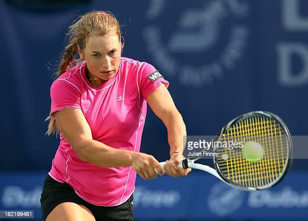 Yulia Putintseva of Kazakhstan plays a backhand in her match against Agnieszka Radwanska of Poland during day three of the WTA Dubai Duty Free Tennis...
