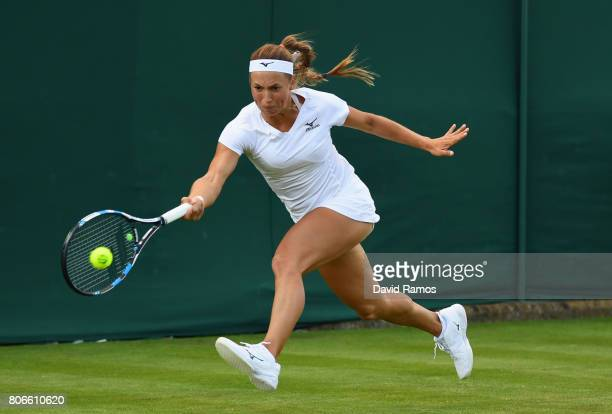 Yulia Putintseva of Kazakhstan plays a forehand during the Ladies Singles first round match against Anastasija Sevastova of Latvia on day one of the...
