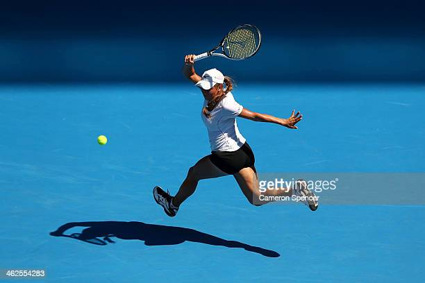 Yulia Putintseva of Kazakhstan plays a forehand in her first round match against Agnieszka Radwanska of Poland during day two of the 2014 Australian...