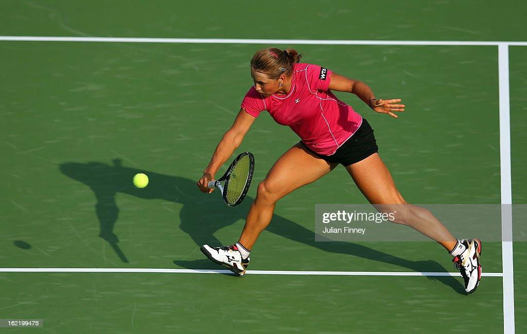 Yulia Putintseva of Kazakhstan plays a volley in her match against Agnieszka Radwanska of Poland during day three of the WTA Dubai Duty Free Tennis Championship on February 20, 2013 in Dubai, United Arab Emirates.
